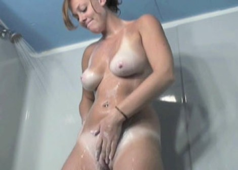 Redhead Mariah plays in the shower